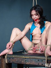 Alex More get her body wrapped tightly with ropes